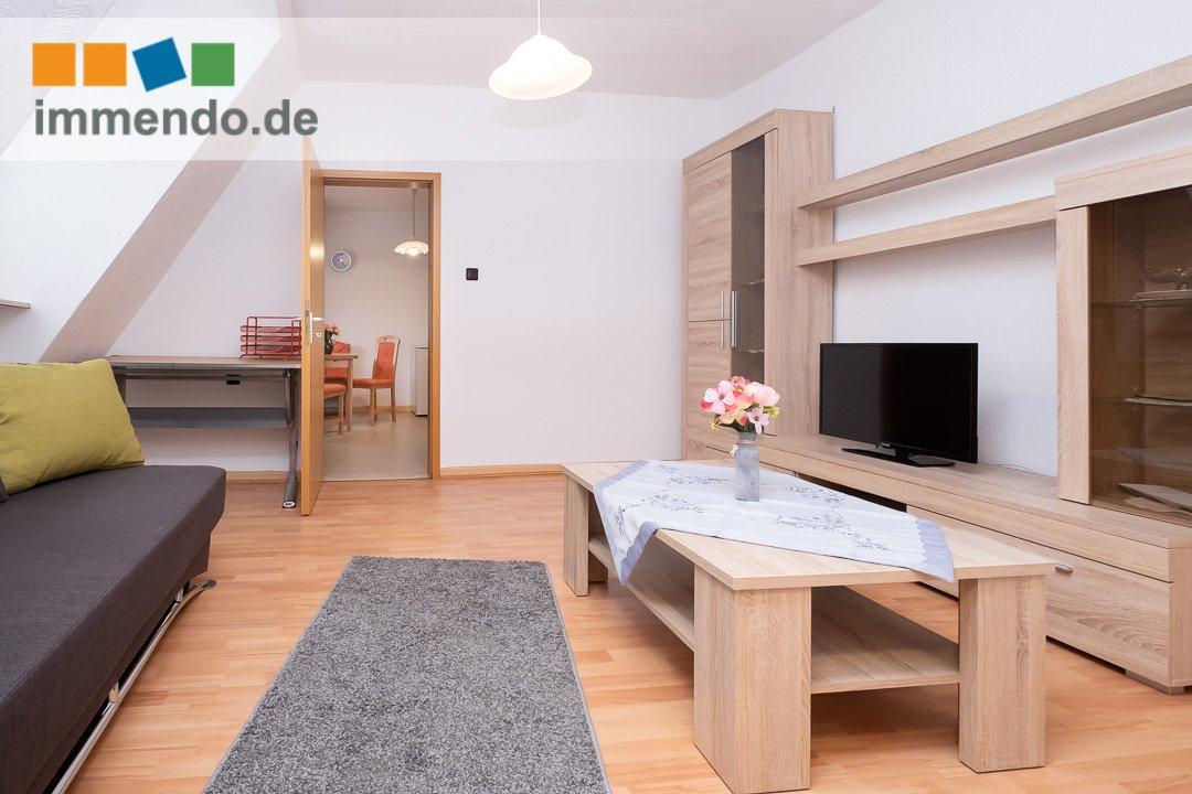 Überblick Wohnzimmer mit Flatscreen TV
